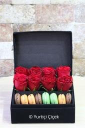 Kutu içerisinde makaronlar ve kırmızı güller ile hazırlanan özel tasarım sevdiklerinizi mutlu etmeye yeter.